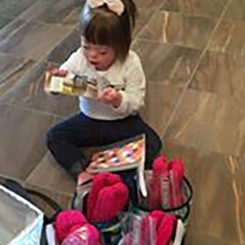 Adele playing with her baskets