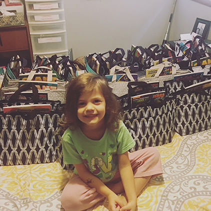 Holly's daughter surrounded by care bags