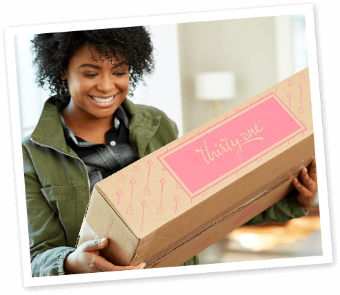 a women opening a box of products