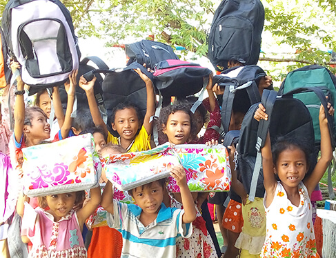 kids receiving charitable donations