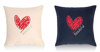 Pillows embroidered with a Gives Heart