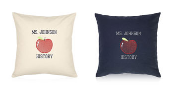 Pillows embroidered with an apple