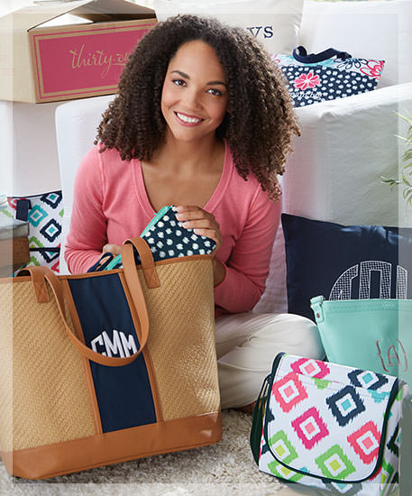 Hostess surrounded by Thirty-One bags